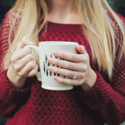 woman with wedding band holding a coffee mug how to be a better wife nurturing your marriage