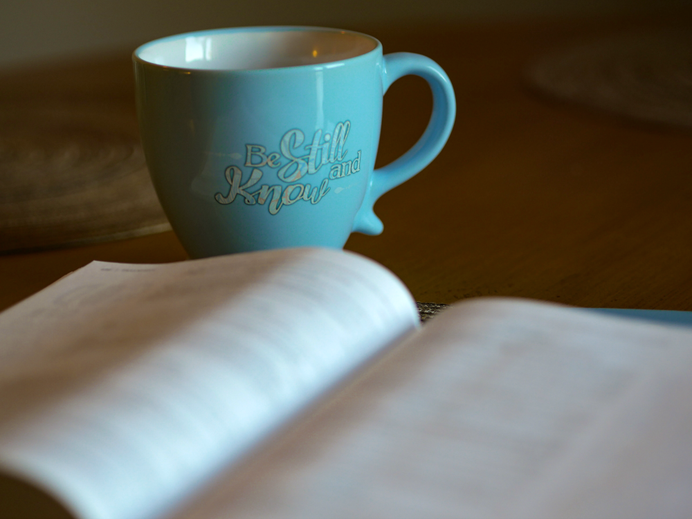cup with be still on it and Bible balancing my past self with my new self