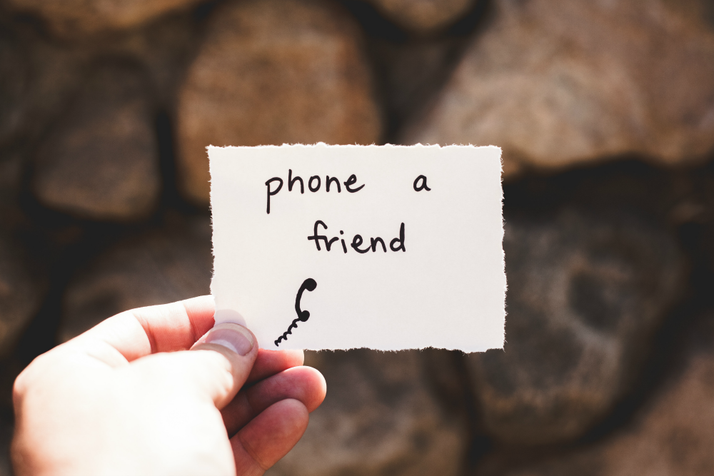 overcoming life's obstacles don't be afraid to ask for help person holding a note that says phone a friend